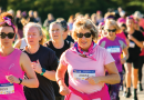 Participants run the beach for breast cancer awareness